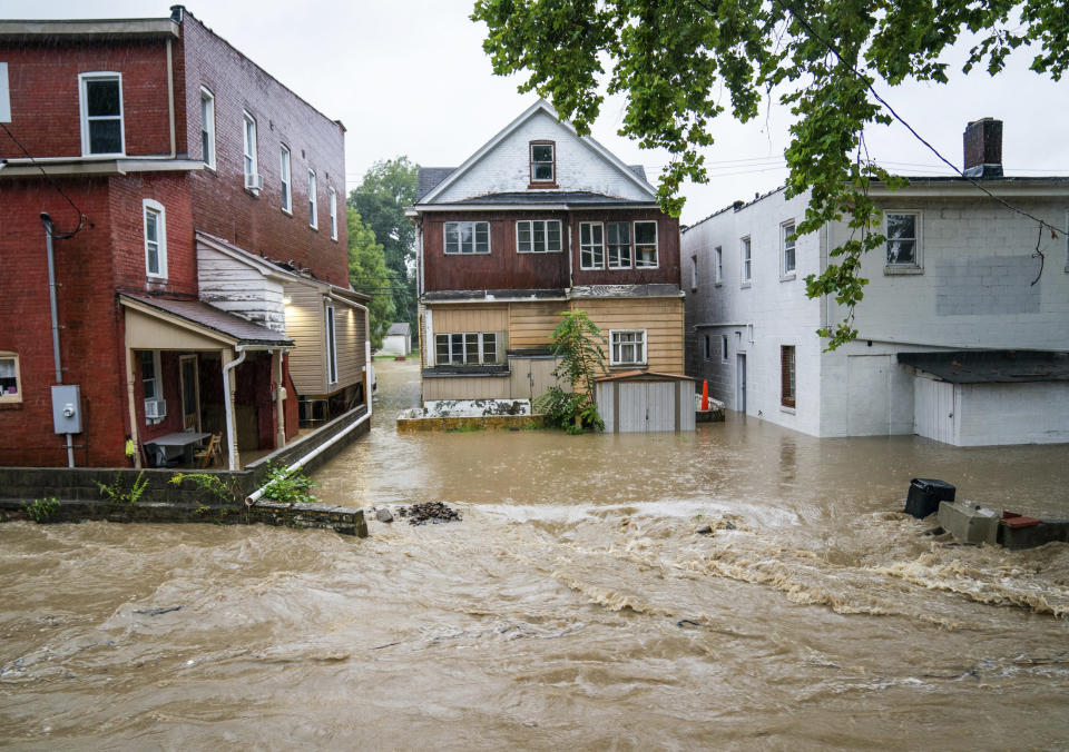Water floods a street Wednesday, Sept. 1, 2021, in Bridgeville, Pa. Pennsylvanians braced for downpours and high winds from the remnants of Hurricane Ida, with forecasters warning that creeks, streams and rivers would be inundated across the state's southern tier. (Andrew Rush/Pittsburgh Post-Gazette via AP)