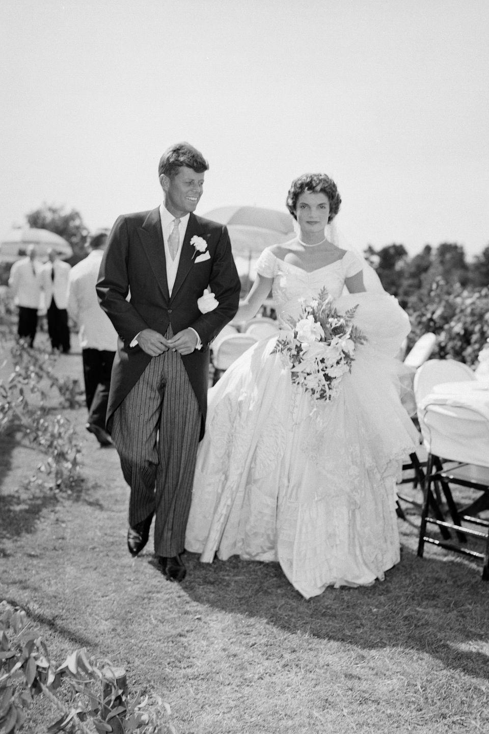 """<p>John F. Kennedy and Jacqueline Bouvier tied the knot in a September wedding in Newport, Rhode Island. The couple said """"I do"""" in St. Mary's Roman Catholic Church and held an elegant reception at the bride's family estate, Hammersmith Farm. </p>"""