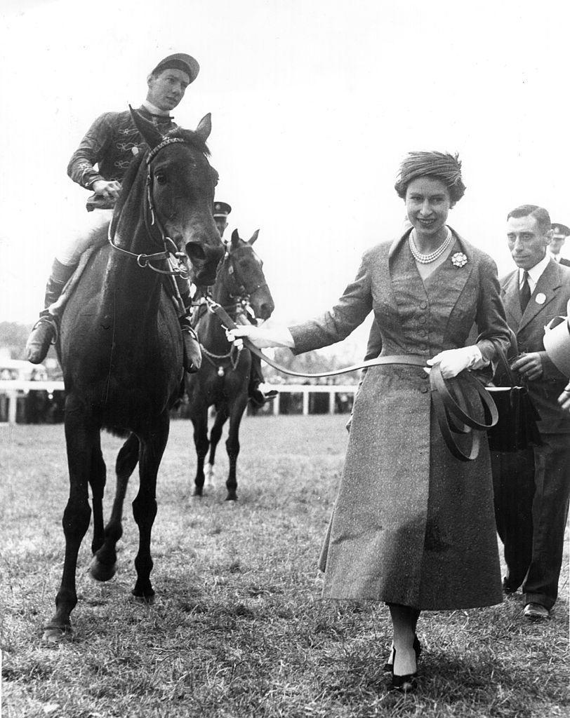 <p>Here she leads her first classic winner, a filly named Carrozza, at the Oaks in Epsom.</p>