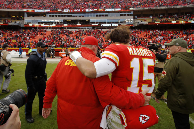 Kansas City Chiefs quarterback Patrick Mahomes (15) walks off the field after head coach Andy Reid after their NFL football game against the Arizona Cardinals Sunday, Nov. 11, 2018, in Kansas City, Mo. The Chiefs won 26-14. (AP Photo/Charlie Riedel)