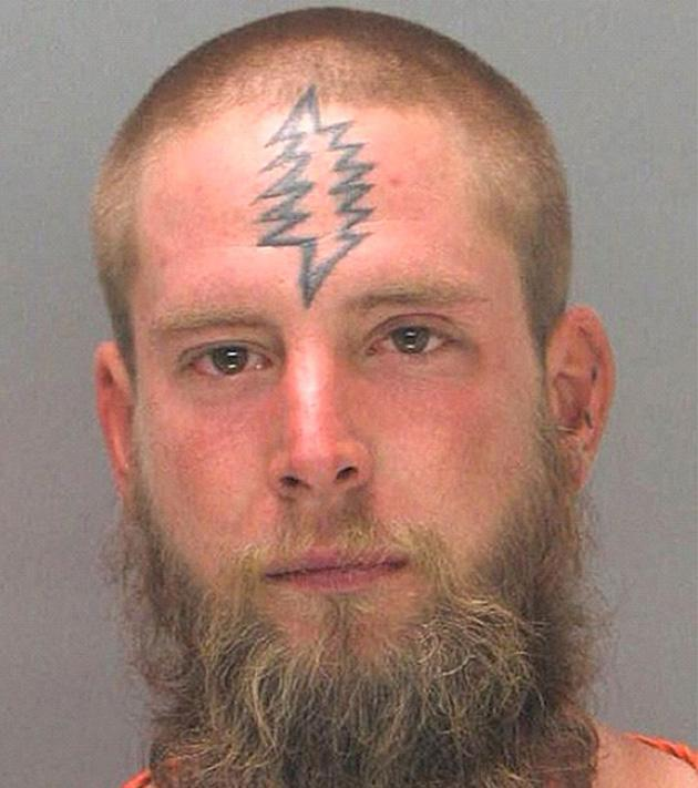 An unidentified bearded man with a tattoo that looks like a Christmas tree (Rex Features)