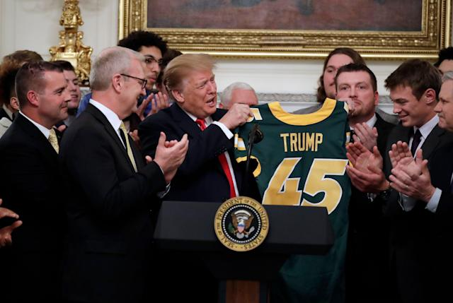 President Donald Trump received a No. 45 North Dakota State jersey. (AP Photo)