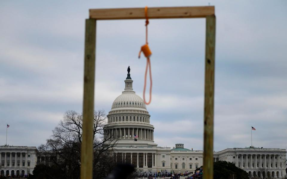 A noose is seen on makeshift gallows as supporters of US President Donald Trump gather on the West side of the US Capitol  - Andrew Caballero-Reynolds/AFP