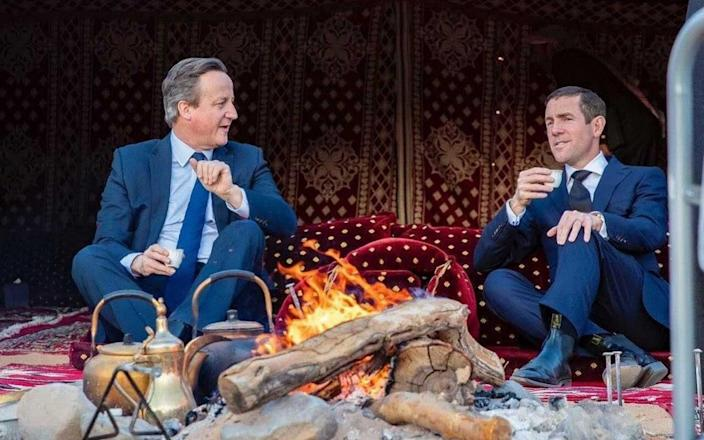 David Cameron and Lex Greensill relax during a trip to Saudi Arabia, on which they met Crown Prince Mohammed bin Salman. Mr Cameron said he raised the issue of human rights, but this picture has led activists to challenge him - WALL STREET JOURNAL