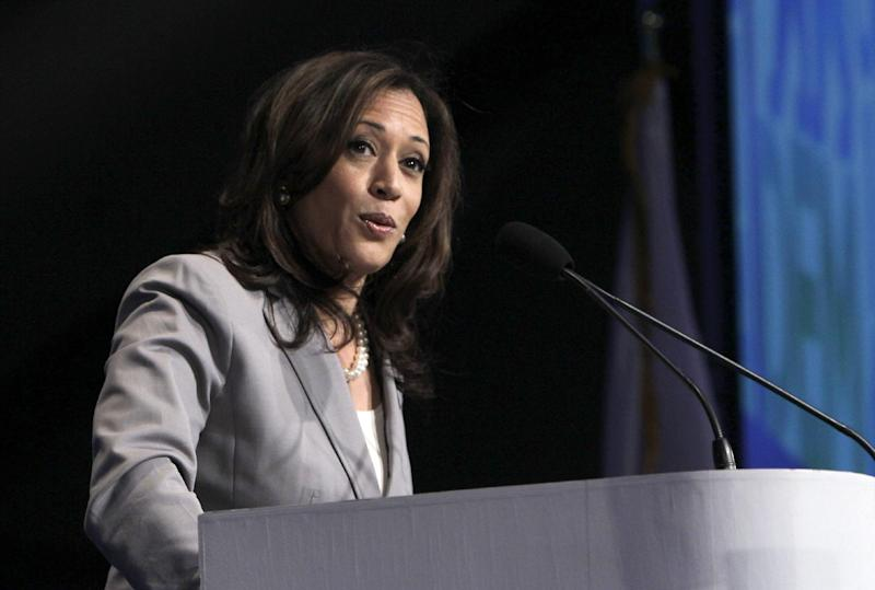 """FILE - This April 13, 2013 file photo shows Attorney General Kamala Harris speaking before delegates to the 2013 Democratic Party state convention in Sacramento, Calif.  President Barack Obama introduced California's Kamala Harris at a Democratic fundraiser as brilliant, dedicated, tough and """"by far, the best looking attorney general in the country."""" The remark  raised a few eyebrows over whether it amounted to sexism. The president, who has similarly complimented men before, called Harris and apologized. A Harris spokesman assured the world she remains an Obama supporter. But the question lingers. Male-to-female, female-to-male, peer-to-peer, superior-to-subordinate: Are workplace compliments focused on looks or other personal details like dress ever OK? (AP Photo/Rich Pedroncelli, file)"""