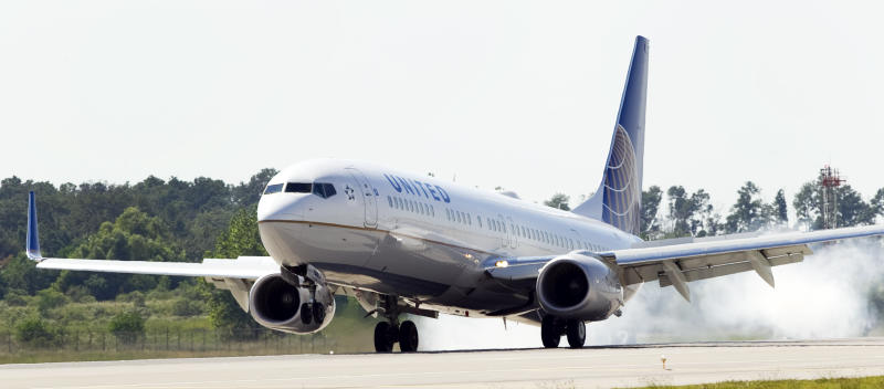 FILE - In this Oct. 1, 2010 file photo, United Airlines flight 747 lands at George Bush Intercontinental Airport painted with the new logo, in Houston. United Continental Holdings Inc. said Thursday, Oct. 21, its two airlines both posted profits in their last quarters as independent airlines. (AP Photo/Houston Chronicle, Brett Coomer, file) MANDATORY CREDIT.