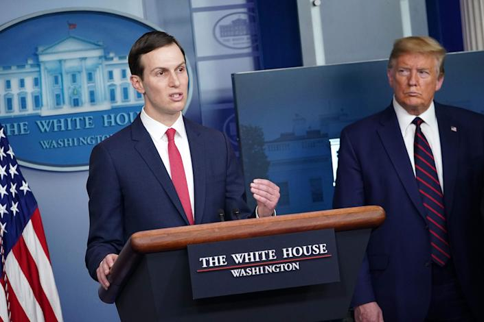 <p>Senior Advisor to the President Jared Kushner (L) speaks, flanked by US President Donald Trump, during the daily briefing on the novel coronavirus in April.</p> (AFP via Getty Images)