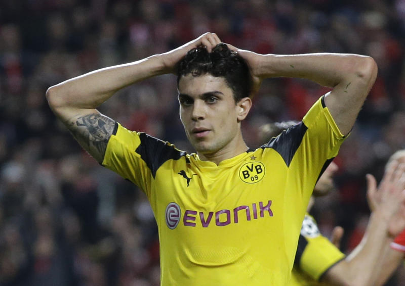 FILE - In this file photo dated Tuesday, Feb. 14, 2017, Dortmund's Marc Bartra reacts during the Champions League round of 16, first leg, soccer match between Benfica and Borussia Dortmund at the Luz stadium in Lisbon. Borussia Dortmund said Tuesday April 11, 2017, defender Marc Bartra was injured in an explosion near team bus and is currently in a hospital. (AP Photo/Armando Franca, FILE)