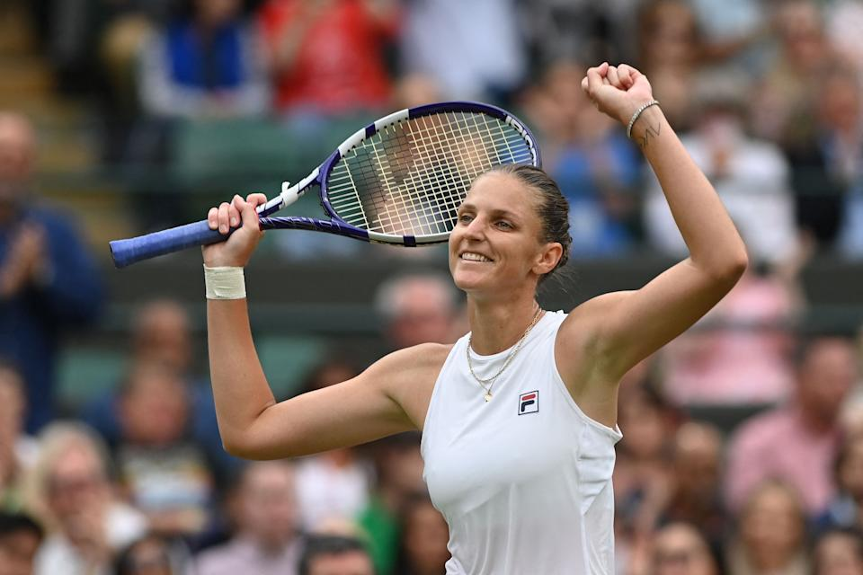 Czech Republic's Karolina Pliskova celebrates her win over Switzerland's Viktorija Golubic during their women's quarter-final tennis match on the eighth day of the 2021 Wimbledon Championships at The All England Tennis Club in Wimbledon, southwest London, on July 6, 2021. - RESTRICTED TO EDITORIAL USE (Photo by Glyn KIRK / AFP) / RESTRICTED TO EDITORIAL USE (Photo by GLYN KIRK/AFP via Getty Images)