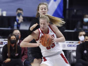 North Carlolina State's Elissa Cunane (33) drives around Virginia Tech's Elizabeth Kitley during the first half of an NCAA college basketball game in the Atlantic Coast Conference women's tournament in Greensboro, N.C., Friday, March 5, 2021. (Ethan Hyman/The News & Observer via AP)