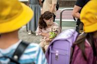 Residents of Tokyo's Karasuyama are grrrateful for the security and cuddles provides by their canine protectors