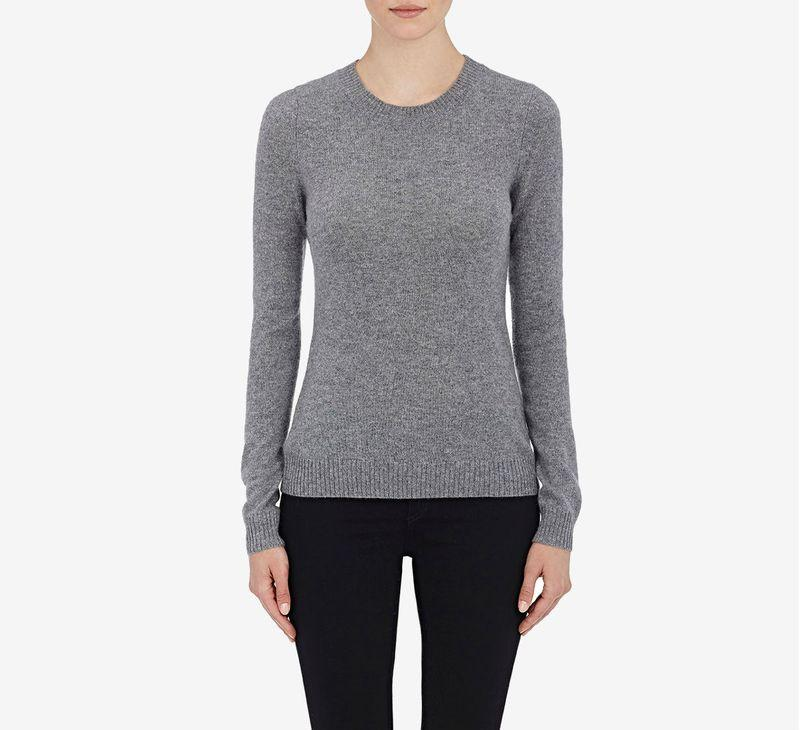A model wearing a Barneys gray cashmere sweater