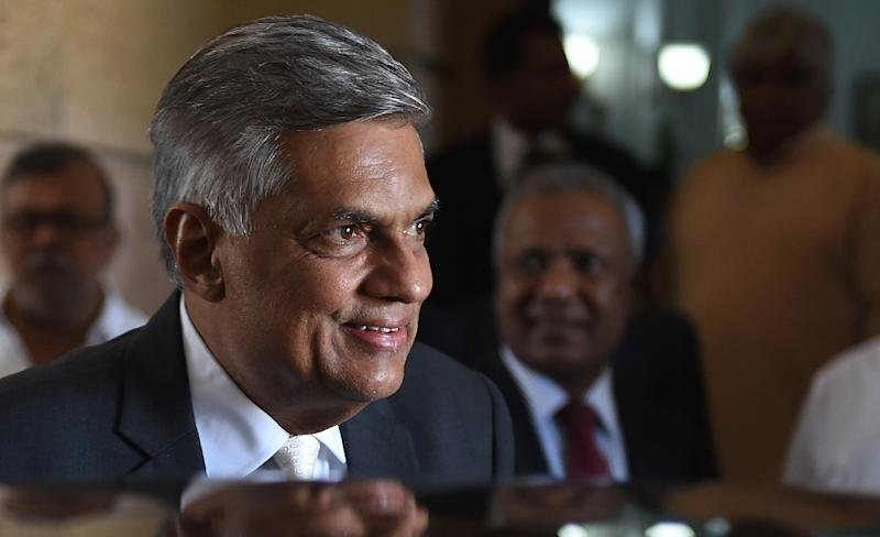 Sri Lanka's Prime Minister Ranil Wickremesinghe leaves after his swearing-in ceremony in Colombo, on August 21, 2015 (AFP Photo/Ishara S. Kodikara)