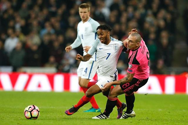 England's midfielder Raheem Sterling (L) vies with Scotland's midfielder Scott Brown during a World Cup 2018 qualification match between England and Scotland at Wembley stadium in London on November 11, 2016 (AFP Photo/Ian Kington)