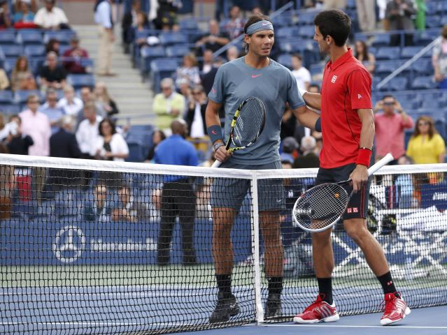 Rafael Nadal of Spain (L) and Novak Djokovic of Serbia greet each other before their men's final match at the U.S. Open tennis championships in New York, September 9, 2013. REUTERS/Mike Segar (UNITED STATES - Tags: SPORT TENNIS)