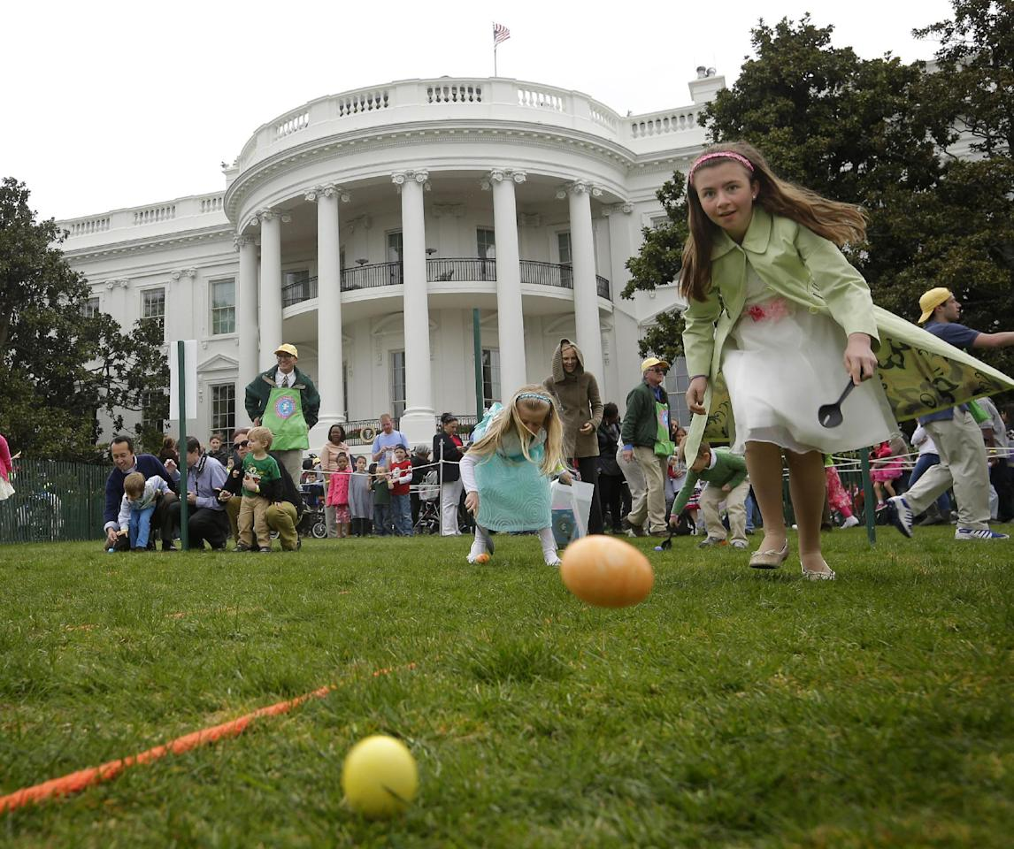 FILE - This April 1, 2013 file photo shows children participating in the annual White House Easter Egg Roll on the South Lawn of the White House in Washington. The White House says the Easter Egg Roll will be held on Monday, April 21. Dating to 1878 and attended by tens of thousands of children and parents, the event will support first lady Michelle Obama's anti-childhood obesity initiative. It will feature sports courts, cooking stations, live music and storytelling, as well as the traditional rolling of hard-boiled eggs across the South Lawn. (AP Photo/Pablo Martinez Monsivais, File)