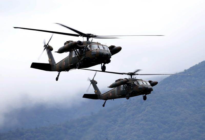 Japanese Ground Self-Defense Force UH-60 Black Hawk helicopters take part in an annual training session, which is based on a scenario to defend or retake islands in Japanese territory, near Mount Fuji at Higashifuji training field in Gotemba