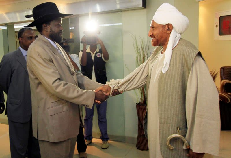 FILE PHOTO: First Vice President Salva Kiir welcomes former prime minister Al-Sadiq Al-mahdi in Khartoum