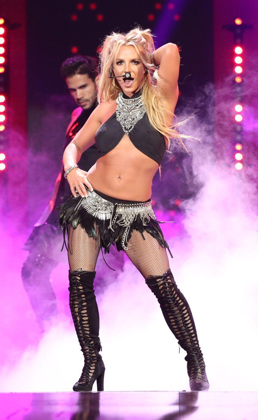 <p>Britney Spears hits the stage at the 2016 iHeartRadio Music Festival in Las Vegas on September 24, 2016.</p>