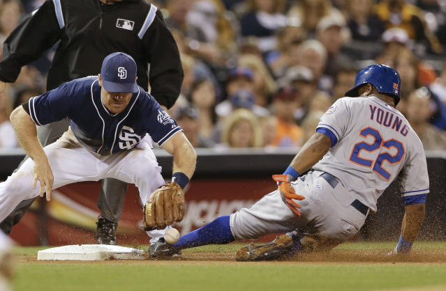 San Diego Padres third baseman Logan Forsythe, left, drops the ball as New York Mets' Eric Young Jr., right, safely steals third base during the seventh inning in a baseball game on Saturday, Aug. 17, 2013, in San Diego. (AP Photo/Gregory Bull)