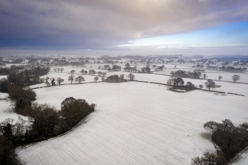 A dusting of snow and a light mist covers the Cheshire countryside at Knutsford. (Getty Images)