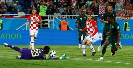 Soccer Football - World Cup - Group D - Croatia vs Nigeria - Kaliningrad Stadium, Kaliningrad, Russia - June 16, 2018 Nigeria's Francis Uzoho makes a save from Croatia's Mateo Kovacic REUTERS/Fabrizio Bensch