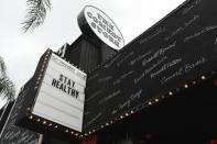"""FILE - The marquee for The Comedy Store nightclub reads """"Stay Healthy"""", on March 16, 2020, in West Hollywood, Calif. Los Angeles Mayor Eric Garcetti ordered all of the city's bars, nightclubs, restaurants, gyms and entertainment venues to close in order to prevent the spread of the coronavirus. (AP Photo/Chris Pizzello, File)"""