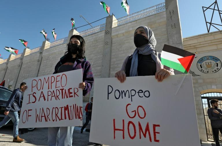 Palestinians demonstrate near the Israeli settlement of Psagot, built on the lands of the city of al-Bireh, against the visit by US Secretary of State Mike Pompeo