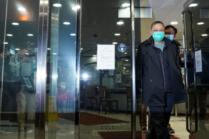 Pro-democracy activist Benny Tai leaves the police station on bail in Hong Kong