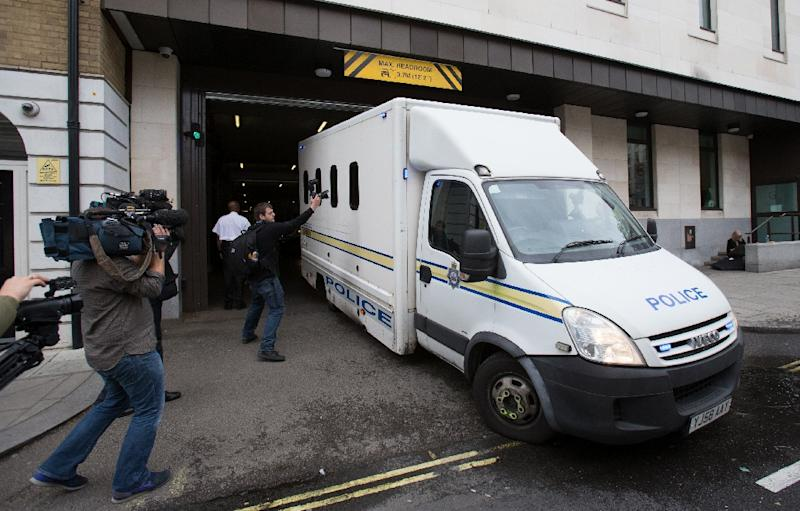 A prison van is driven out of Westminster Magistrates Court in central London, on June 18, 2016 (AFP Photo/Daniel Leal-Olivas)