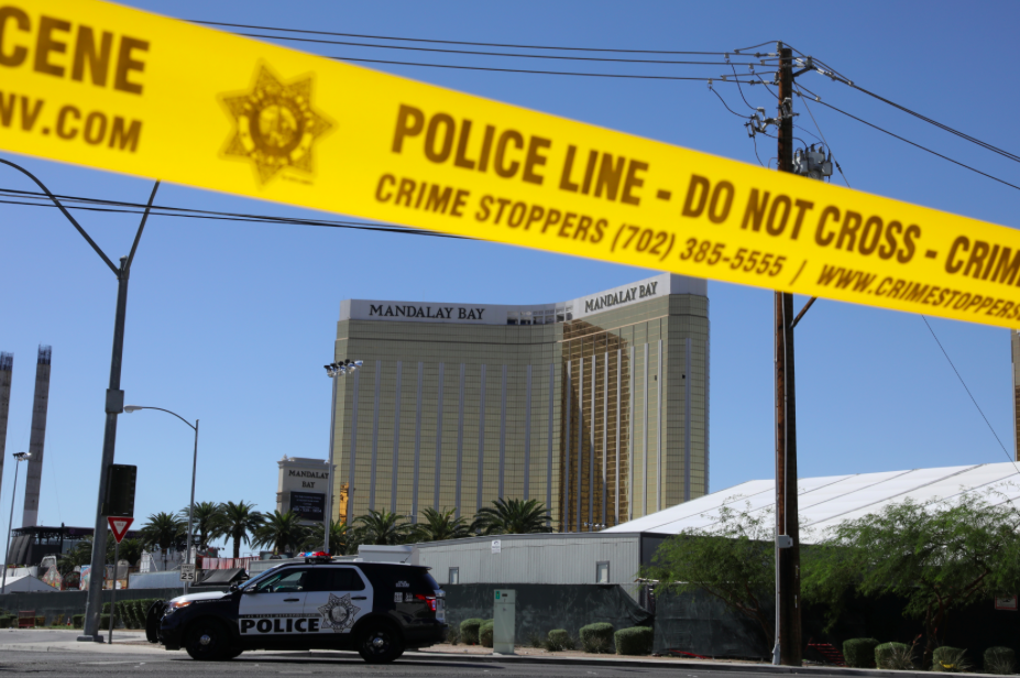 <p>Two smashed windows of the Mandalay Bay hotel stand as a devastating reminder of what happened. (Reuters) </p>