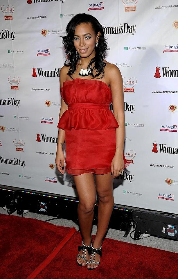 "Here's another red ruffled dress, courtesy of Solange Knowles. Bennett Raglin/<a href=""http://www.wireimage.com"" target=""new"">WireImage.com</a> - January 11, 2009"