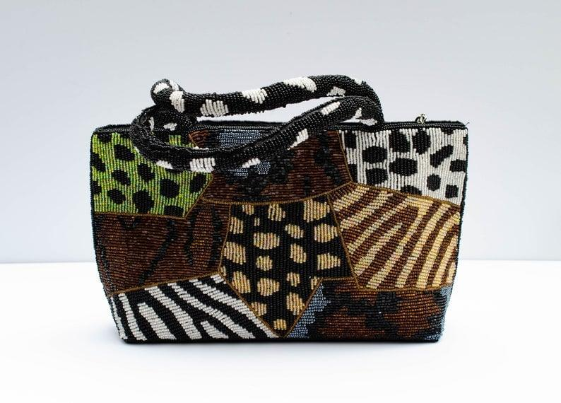<p><span>VEtsy intage Eclectic Style Beaded Purse/Handbag with Animal</span> ($74)</p>