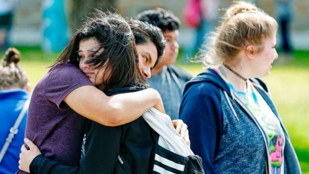 PHOTO: Santa Fe High School freshman Caitlyn Girouard, center, hugs her friend outside the Alamo Gym where students and parents wait to reunite following a shooting at Santa Fe High School, May 18, 2018, in Santa Fe, Texas. (Michael Ciaglo/Houston Chronicle via AP)