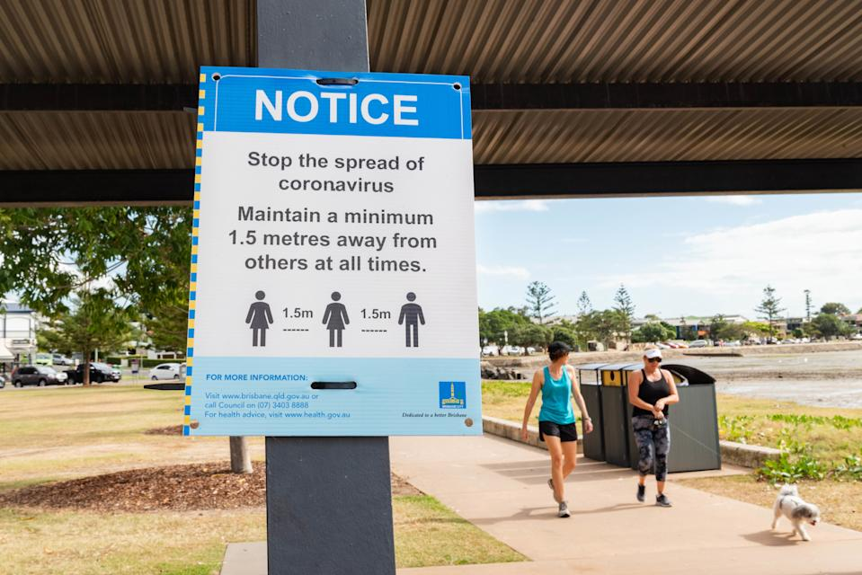 A sign in Brisbane informs the public about social distancing amid the Covid-19 pandemic. Source: SOPA