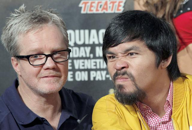 Manny Pacquiao, right, of the Philippines, and his trainer Freddie Roach, left, appear at a news conference in Beverly Hills, Calif., Thursday, Aug 8, 2013, to promote Pacquiao's upcoming boxing match against Brandon Rios. Pacquiao and Rios are scheduled to fight in a welteweight match at The Venetian Macao in Macau on Nov. 24. (AP Photo/Nick Ut)