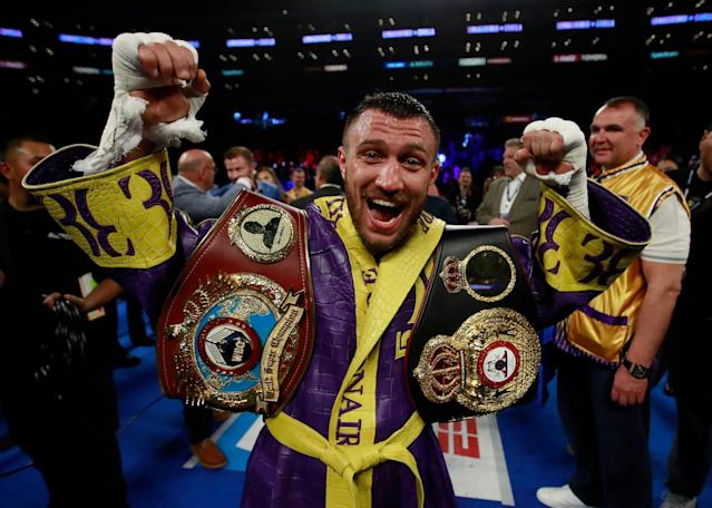 Vasiliy Lomachenko celebrates after beating Ant Crolla in Los Angeles. (Reuters)