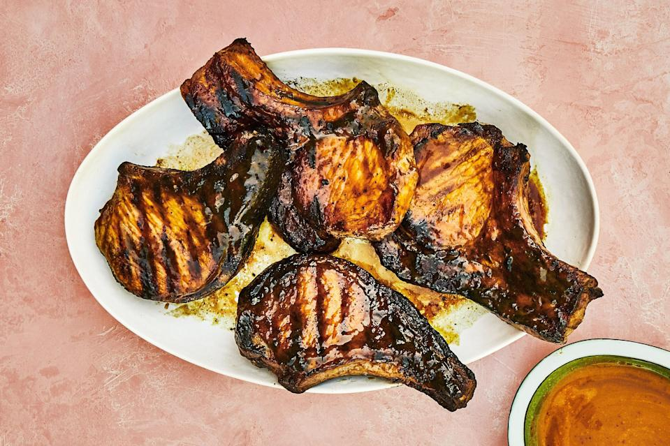 """The sweet-and-sour glaze on these pork chops gets them good and dark, coating them with rich flavor—don't be afraid to let them get a little black. <a href=""""https://www.epicurious.com/recipes/food/views/grilled-pork-chops-with-pineapple-turmeric-glaze?mbid=synd_yahoo_rss"""" rel=""""nofollow noopener"""" target=""""_blank"""" data-ylk=""""slk:See recipe."""" class=""""link rapid-noclick-resp"""">See recipe.</a>"""