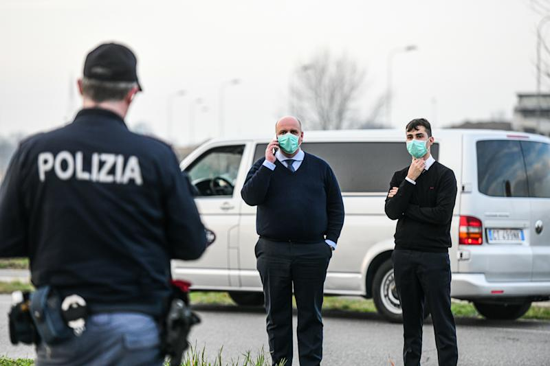 Casalpusterlengo, Italy - 23 February 2020: Italian State Police officers check cars and passengers moving in and out of the city as restrictive measures are taken to contain the outbreak of Coronavirus COVID-19 (Photo by Piero Cruciatti/Sipa USA)