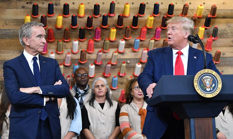 Arnault and President Trump give remarks during the opening ceremony.