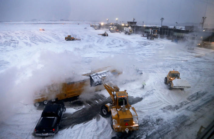 <p>Front loaders dump snow into a melter while clearing the apron around Gates C and D at Terminal B at LaGuardia Airport, Thursday, Jan. 4, 2018, in New York. (Photo: Julie Jacobson/AP) </p>