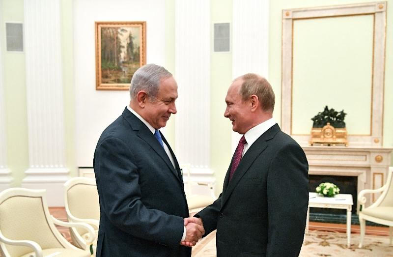 Russian President Vladimir Putin (R) shakes hands with Israeli Prime Minister Benjamin Netanyahu during their meeting at the Kremlin in Moscow on July 11, 2018