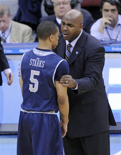 Georgetown coach John Thompson III, right, talks with Markel Starks after Seton Hall defeated Georgetown 73-55 in an NCAA college basketball game, Tuesday, Feb. 21, 2012, in Newark, N.J. (AP Photo/Bill Kostroun)