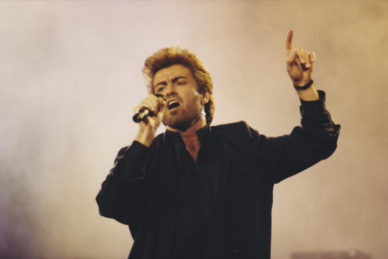 English singer, songwriter and musician, George Michael (1963-2016) performs live on stage at an Aids awareness charity concert at Wembley Arena in London in April 1987. (Photo by Michael Putland/Getty Images)