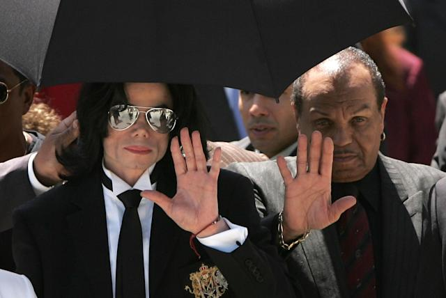 Michael Jackson, left, and his father, Joe Jackson, wave to fans in Santa Maria, Calif., in 2005. (Photo: Win McNamee/Getty Images)