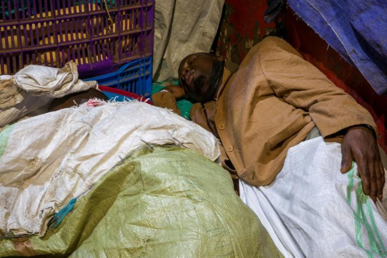 The less fortunate are forced to sleep in the open, curled up on sheets of cardboard or hessian sacks in a vain attempt to keep warm