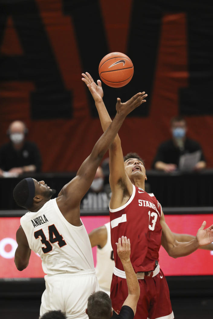 Stanford's Oscar da Silva (13) and Oregon State's Rodrigue Andela (34) go up for the tip-off during the first half of an NCAA college basketball game in Corvallis, Ore., Monday, Jan. 4, 2021. (AP Photo/Amanda Loman)