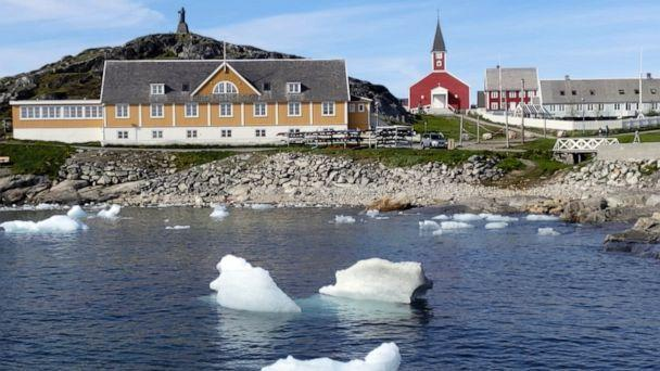 PHOTO: Small pieces of ice float in the water off the shore in Nuuk, Greenland, June 13, 2019. (Sandy Virgo/AP)