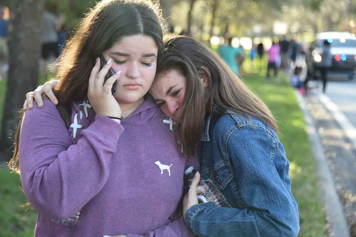 Students react following a shooting at Marjory Stoneman Douglas High School.