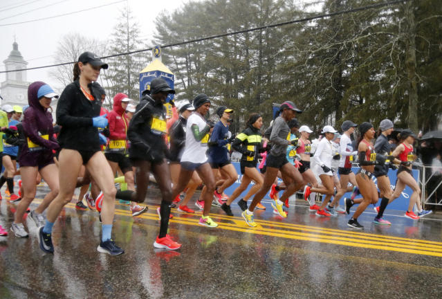 The elite female runners break from the starting line in a downpour during the 122nd running of the Boston Marathon in Hopkinton, Mass., Monday, April 16, 2018. (AP Photo/Mary Schwalm)